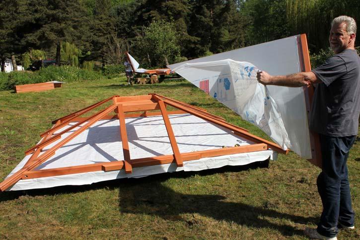 man assembling a gazebo roof