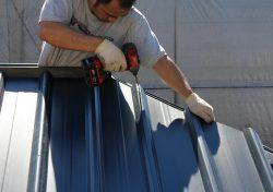 a man installing a gazebo roof
