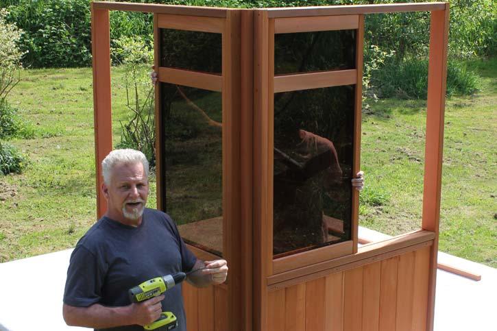 a man installing a gazebo corner walls