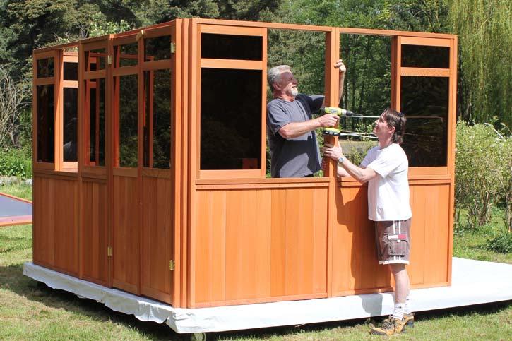 two men attaching a hot tub walls