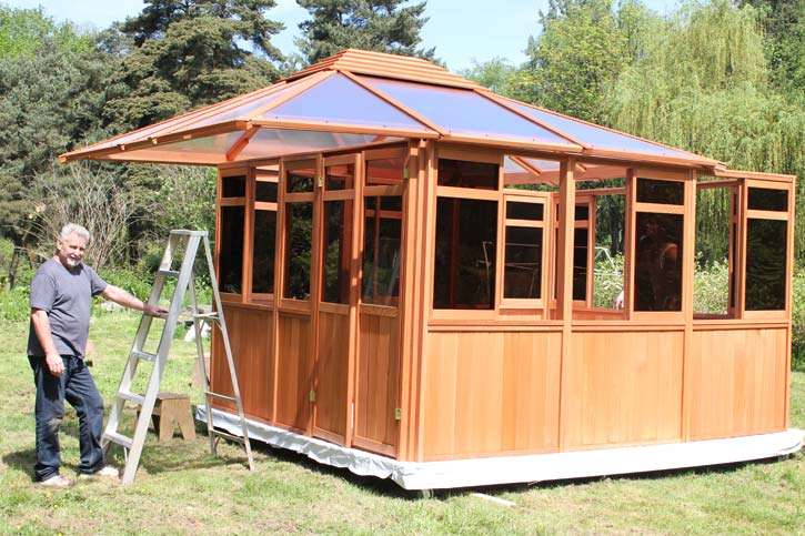 two men installing a completed gazebo roof