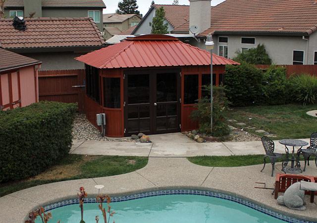 an Aspen gazebo beside a swimming pool