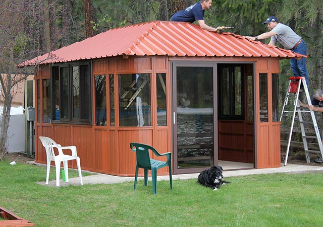men installing a gazebo roof