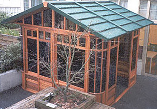 a gazebo with green roof