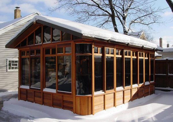 chalet gazebo with snow on the roof