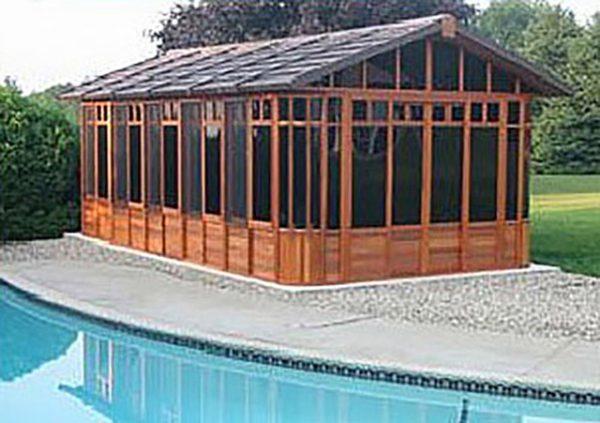 chalet gazebo beside a swimming pool