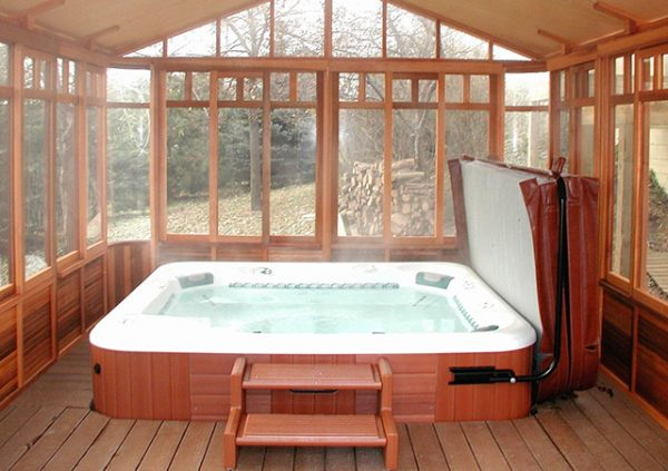 chalet gazebo interior view with a hot tub