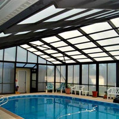 swimming pool inside a gazebo enclosure