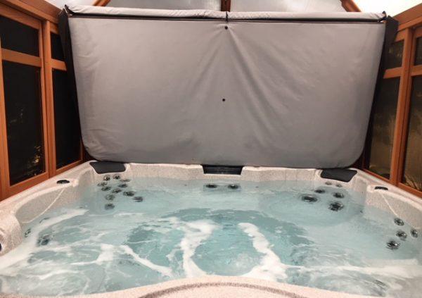 a hot tub inside a gazebo
