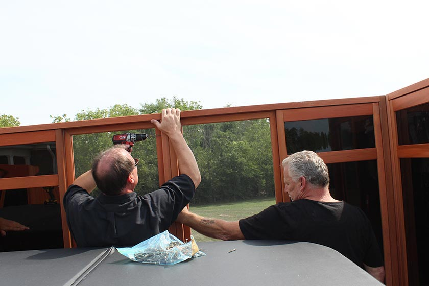 Men Working On Window Walls - Spa Gazebo|Hot Tub Enclosure - Westview Manufacturing