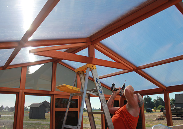 Man Working On The Roof Panel - Spa Gazebo|Hot Tub Enclosure - Westview Manufacturing