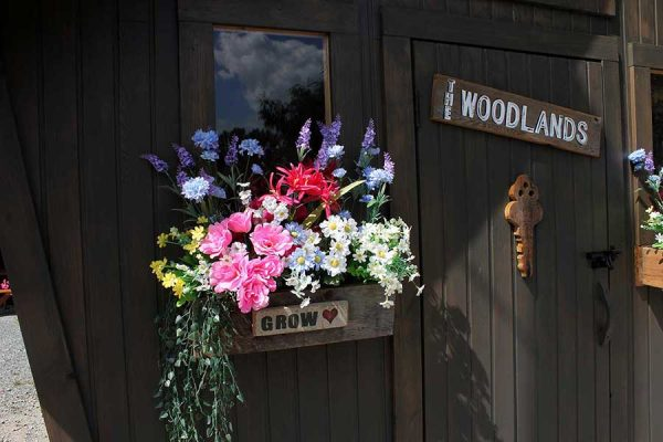 a Woodlands cabin front